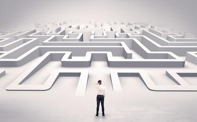 Fototapeta Businessman getting ready to enter a 3D flat labyrinth concept