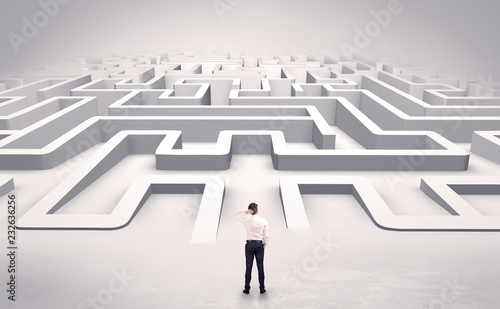 Businessman getting ready to enter a 3D flat labyrinth concept