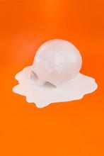 A White Skull Melting On An Or...