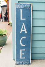 Lace Sign In Front Of A Small Shop