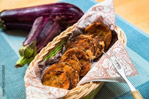 Fototapeta Basket with fried aubergine on table. obraz