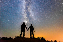 Silhouette Of Couple Holding Hands With Milky Way Galaxy Night Stars
