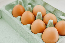 Eggs On Green Container