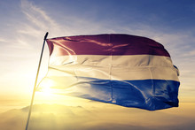 Netherlands Holland Dutch Flag Textile Cloth Fabric Waving On The Top Sunrise Mist Fog