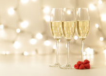 Three Flutes Of Golden Champagne