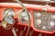 Steering wheel and dashboard in vintage car