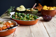 Turkey Dinner And Side Dishes On A Wood Background.