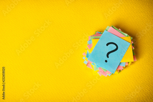 Fotomural  question marks written reminders tickets on yellow vintage paper background