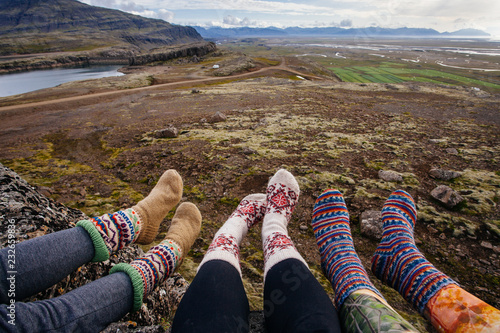 Legs in socks with beautiful ornament , on the Iceland nature and moss Wallpaper Mural