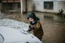 Boy At The Snow