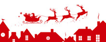 Santa's Sleigh Flying Over Roofs