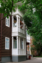 Wooden House With Carved Polisade In Vologda. Russian Traditional Architecture Lies In Wooden Houses With Manually Carved Decorations, Often Painted In White