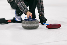 Curling: Male Thrower About To Push Off From Hack