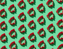 Red Christmas Tree-shaped Cookie Cutters On  Green Background