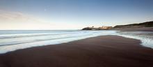 Deserted Beach At Dusk