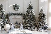 Christmas Tree Is Dressed Up In A White Room. On The Christmas Tree Colored Balls Of Blue And Pink. The Concept Of Celebration And Fun.