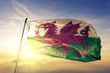 canvas print picture Wales welsh flag textile cloth fabric waving on the top sunrise mist fog