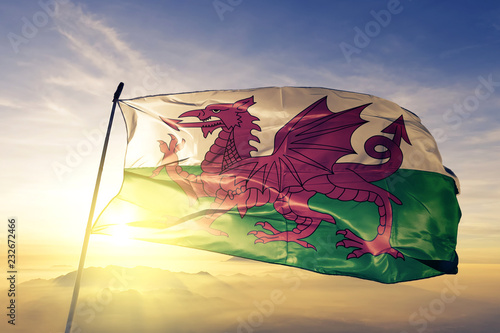 Wales welsh flag textile cloth fabric waving on the top sunrise mist fog Wallpaper Mural