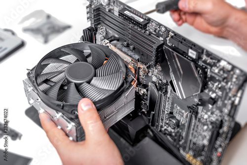 Obraz Installing or repair the air cooling system of the PC processor. - fototapety do salonu