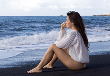 Young Woman On Black-sand Beach