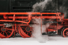 Steam Train Riding Through Winter Forest