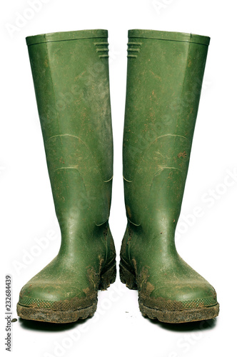 Photo Wellington boots covered in mud, cut out
