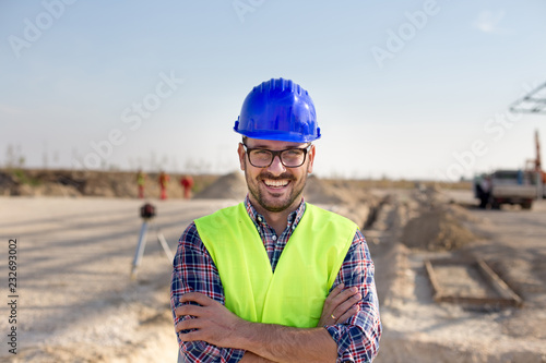 Valokuva  Engineer with crossed arms on building site
