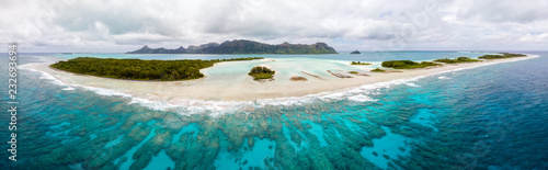 Fotografia, Obraz Aerial view of Raivavae island with beaches, coral reef and motu in azure turquoise blue lagoon