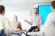 Leinwandbild Motiv Happy confident teacher explaining his students what he thinks about new subject