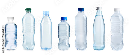 Fotografía  Set with different bottles of pure water on white background