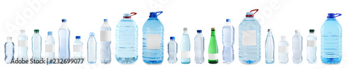Valokuva  Set with different bottles of pure water on white background