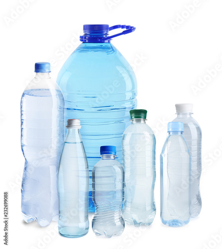 Set with different bottles of pure water on white background