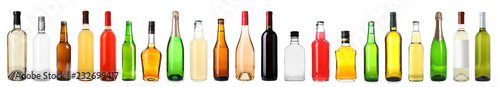 Set of bottles with different drinks on white background