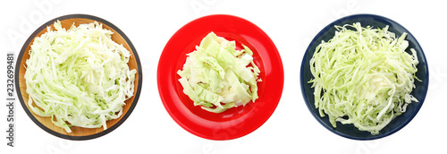Plates with cut cabbage on white background, top view Fototapeta