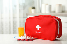 First Aid Kit With Pills On Table Indoors. Space For Text