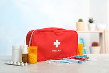 First Aid Kit With Pills On Ta...