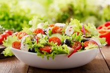 Bowl Of Fresh Salad With Veget...