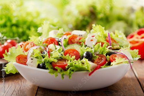 bowl of fresh salad with vegetables and greens Fototapeta