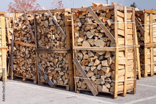 Obraz na płótnie chopped firewood stacked in boxes for sale