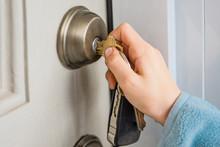 Hand Turns The Key In The Door Lock