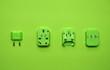 Leinwanddruck Bild - vivid green universal wall electric plug adapter aboard travel set for tourist