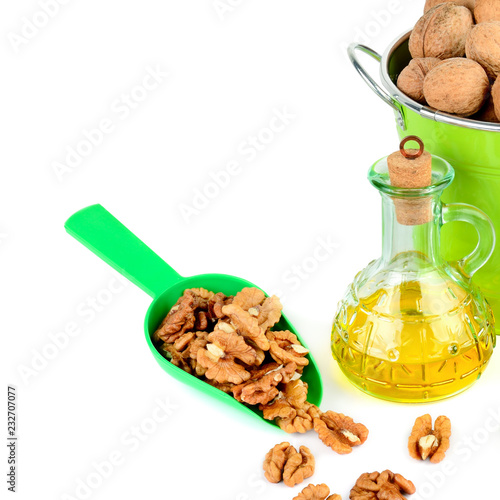 Foto op Canvas Kruiderij Oil of walnut and nut fruit isolated on white background.