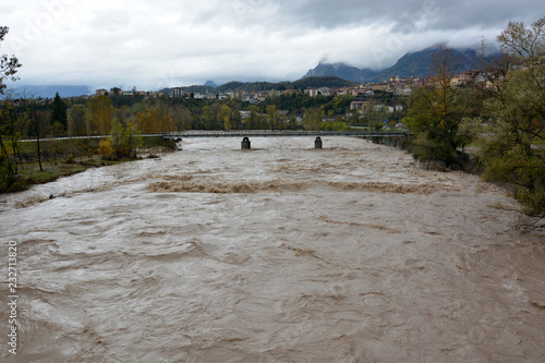 Photo Belluno,Italy,10/30/2018,the river  piave, crossing Belluno After the great wave