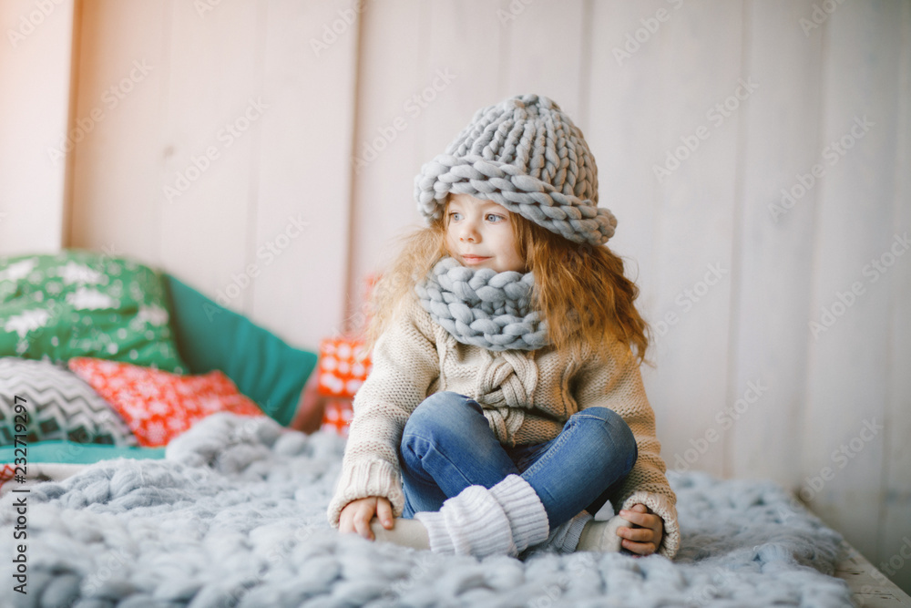 Fototapety, obrazy: baby girl in knitted hat and scarf
