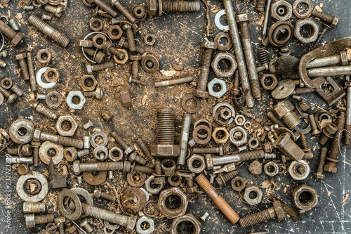 Fotografie, Obraz  Old worn metal bolts and screw-nuts in set