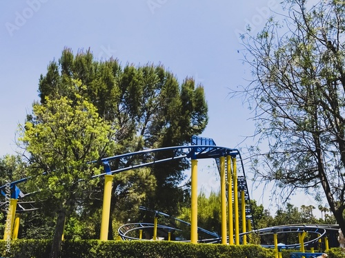 Foto op Canvas Amusementspark Roller Coaster in the Park in the fall