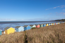 Row Of Colourful Wooden Beach ...
