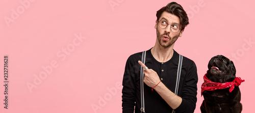 Fotomural Shocked impressed guy has trendy haircut, bristle, wears round glasses, black sh