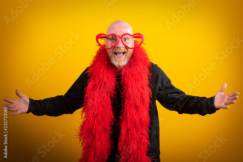 Fotografie, Obraz  Portrait of man being funny with feather boa and heart shaped glasses