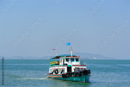 Fotografía  Colorful Ferry Ship in the Sea with No Passenger